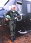Jim Bracewell in front of his Huey at LZ Hammond